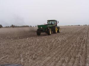Fertliser spreader spreading biochar on a paddock.